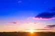canvas print picture - Landscape and dramatic sunset or sunrise sky. Summer or spring meadow nature