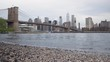 View of the Brooklyn Bridge and Manhattan from the Hudson River. Dolly shot,low angle