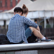 Loving guy and girl spend time together in a summer city