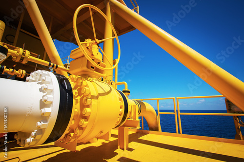 Photo  Manual operate ball valve at offshore oil and gas central processing platform, m
