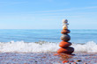 Concept of harmony and tranquility. Rock Zen near the sea
