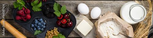 Fotografía Baking concept - ingredients on rustic wood background
