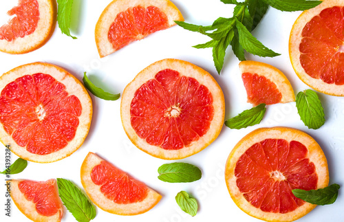 Grapefruit slices and mint leaves isolated