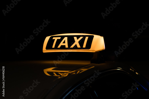 Fotomural taxi sign illuminated, taxi sign at night