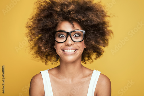 African american girl wearing eyeglasses,smiling.
