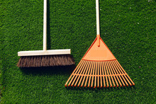 Brush And Broom On A Green Grass