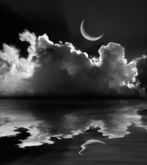 Obraz na SzkleMoonlit fluffy clouds and crescent moon reflection in black and white
