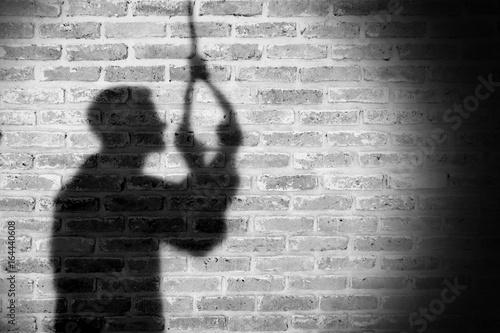 Fotografie, Obraz  Shadow of sad man hanging suicide. light and shadow