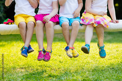 Kids with colorful shoes. Children footwear