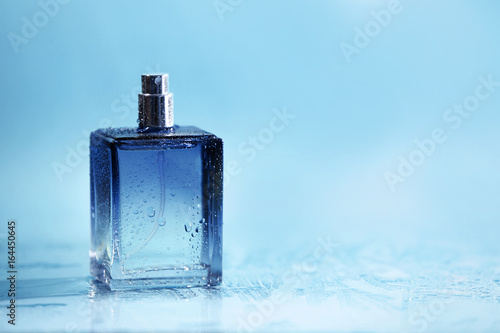 Fotografie, Obraz  Bottle of modern male perfume on color background