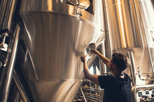 Brewer Working With Industrial...