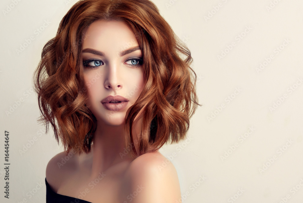 Fototapeta Beautiful model girl with short hair .Woman with red curly hair. Red head .