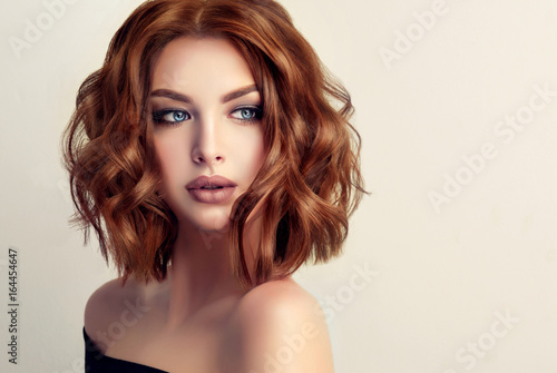 Obraz Beautiful model girl with short hair .Woman with red curly hair. Red head .