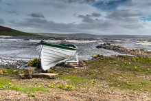 Rowing Boat On Shore Of A Stor...