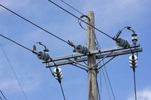 Power Lines On A Concrete Pole