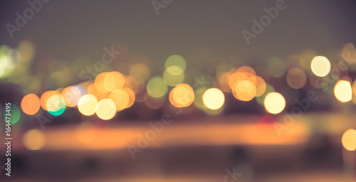 Fotografiet  Defocused blur of city lights at night abstract with vintage tone