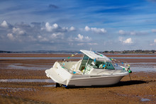 The Modern Boat Of White Color Is Shallow. Low Tide. The River Exe. Exmouth. Devon. England