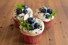 Handmade Capcake With Cream. Muffins With Cream, Chocolate, Mint And Blueberries