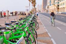 TEL AVIV, ISRAEL- APRIL, 2017: Parked Bicycles In Center Of Tel Aviv.Blurred View Of The Embankment Of Tel Aviv And Bike Roads.