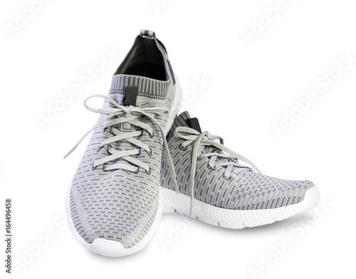 Grey sport male pair shoes isolated.