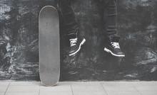 Legs In Sneakers At The Skateb...