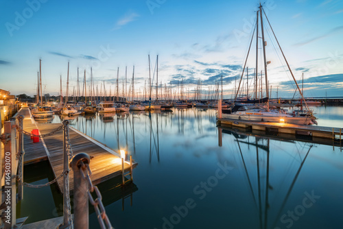 Fotografie, Obraz Nightfall at the idyllic tourist and sailing resort of Yarmouth on the Isle of W