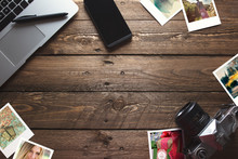 Old Travel Photos And Camera, On Office Wooden Desk Table