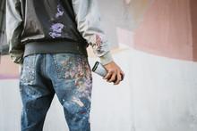 Graffiti Artist With Aerosol S...