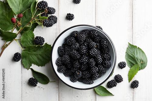 Bowl of fresh ripe blackberries on textured stone background Wallpaper Mural