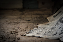 Tattered Old Newspaper Comic Strip From 1943 World War II Lying On Dirty Floor