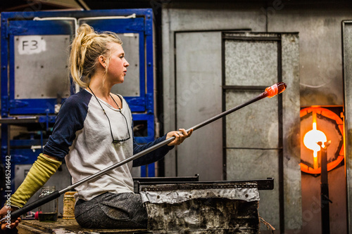 Blowing Glass Professional Woman Working on a Vase. Canvas Print