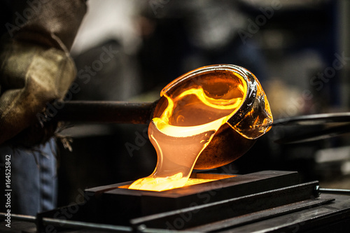Photo Pouring Melted Glass into Graphite Mold