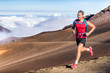 canvas print picture - Trail running runner man on endurance run with backpack on volcano mountain. Ultra marathon race athlete on volcanic rocks path in mountains landscape.