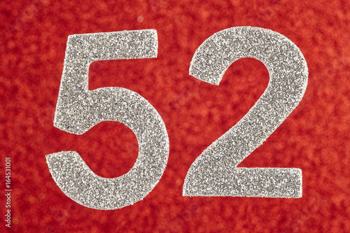 Fotografia  Number fifty-two silver over a red background. Anniversary.