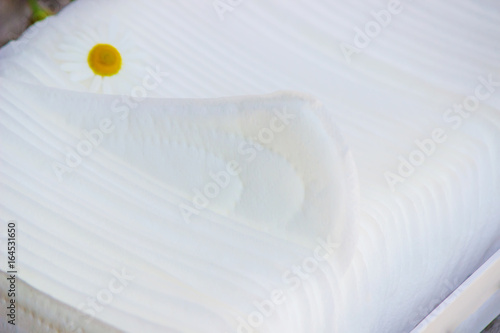 Fotografie, Obraz  Sanitary pads with the scent of chamomile. Selective focus.