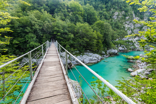 Photo Stands Forest river Wooden Bridge over rover Soca, Slovenia