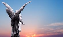 Angel Sculpture Over Bright Sky