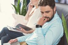 Nervous Bearded Guy Waiting In Queue For Job Talk Indoor
