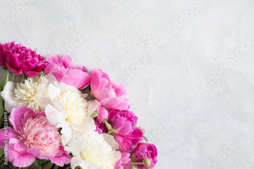 Garden Poster Floral Peonies bouquet on bright gray concrete background with copy space. Wedding, gift, feminine cards, design or mockup projects. Happy Mothers Day, Mother's Day greetings card. Mothers Day gift concept.