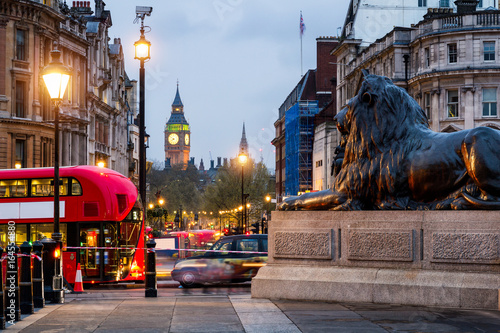 Aluminium Prints London red bus Street view of Trafalgar Square towards Big Ben at night in London, UK
