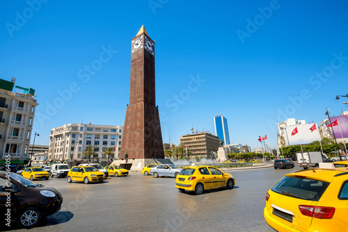 Cityscape with clock tower monument on central square in Tunis city. Tunisia, North Africa