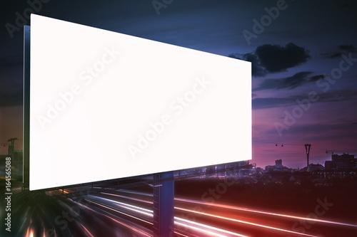 3D rendered illustration of large billboard at night. Light trails in background.