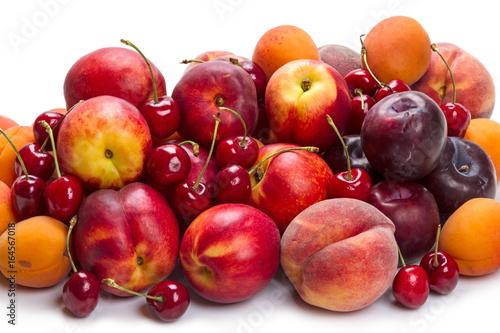 Fotografie, Obraz  Heap ripe fruit on white