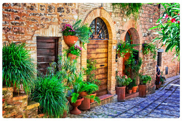 Fototapeta na wymiar Charming floral decorated streets of medieval towns of Italy. Spello in Umbria