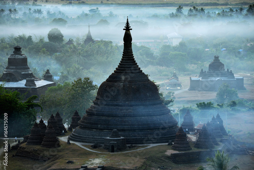 Fotografie, Obraz The plain of mrauk-u Ratanabon Paya on during sunset,Mrauk-u Myanmar