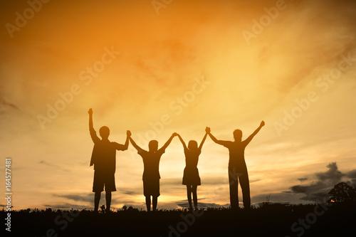 Foto auf Leinwand Orange Silhouette family friendship happy, Concept family.