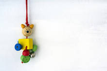Wooden Cat Toy On White Painted Background. Copy Space