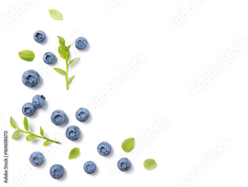 Stampa su Tela Fresh blueberries and leaves, berry ornament frame on white background, closeup,