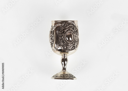 Elegant, silver, vintage cup on white background