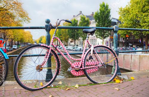 Valokuva  Bycicle parked at the bridge